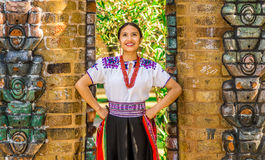 QUITO, ECUADOR - AUGUST, 30 2017: Young indigenous woman wearing a typical andean clothes, holding in her hand a. Colorful blanket Royalty Free Stock Images