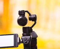 QUITO, ECUADOR- DECEMBER 22, 2017: Osmo Mobile gimbal, new generation of electronic stabilizer in a blurred forest. Background royalty free stock image
