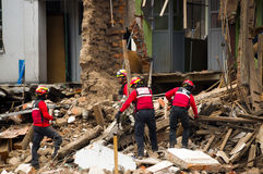 Quito, Ecuador - December 09, 2016: An unidentified group of firemans, cleaning the damage area and destruction, debris. After fire Inferno in buildings royalty free stock image