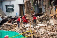 Quito, Ecuador - December 09, 2016: An unidentified group of firemans, Damage and destruction in building After Fire Stock Photo