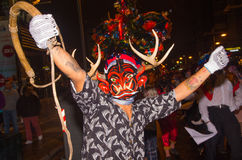 Quito, Ecuador - December 09, 2016: An unidentified man dressed up participating in the Diablada, with a rope in his. Hand and horns in his head in popular town Royalty Free Stock Photo