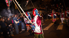 Quito, Ecuador - December 09, 2016: An unidentified people dressed up participating in the Diablada, walking through the. Streets Stock Photos