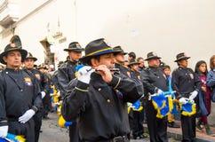 Quito, Ecuador - December 09, 2016: An unidentified people are playing flute in parade in Quito, Ecuador Stock Photos