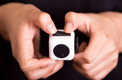 Quito, Ecuador - February 10, 2017: Fidget Cube stress reliever manipulated with both hands.  Royalty Free Stock Image