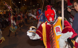 Quito, Ecuador - february 02, 2016: An unidentified man dressed up participating in the Diablada, with a colorful mask. In his head while he is dancing in the Royalty Free Stock Image