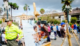 QUITO, ECUADOR, JANUARY 11, 2018: Close up of photographies over a wooden structure at outdoors in plaza grande with. Unidentified people during a protest in stock image