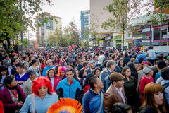 Quito, Ecuador - January 26, 2015: Large crowd celebrating new years during daytime gathering in city streets Stock Photo