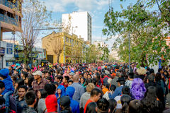 Quito, Ecuador - January 26, 2015: Large crowd celebrating new years during daytime gathering in city streets Royalty Free Stock Photo