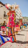 Quito, Ecuador - January 11, 2018: Outdoor view of unidentified people wearing colorful clothes with feathers and. Dancing in the streets during a parade in royalty free stock photos