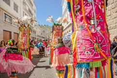Quito, Ecuador - January 11, 2018: Outdoor view of unidentified people wearing colorful clothes with feathers and. Dancing in the streets during a parade in royalty free stock photography