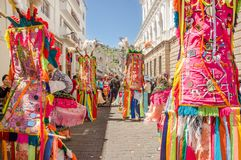Quito, Ecuador - January 11, 2018: Outdoor view of unidentified people wearing colorful clothes with feathers and. Dancing in the streets during a parade in royalty free stock images