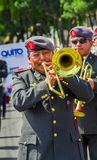 Quito, Ecuador - January 31, 2018: Unidentified goup of man wearing beret and playing trumpets during a festival parade Royalty Free Stock Image
