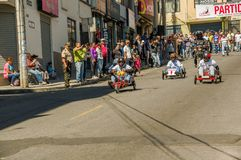 QUITO, ECUADOR - JANUARY 31, 2018: Unidentified man racing a wooden car in an urban road inside of the streets of city. Of Quito Stock Images