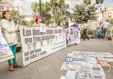 QUITO, ECUADOR, JANUARY 11, 2018: Unidentified people holding a huge banners during a protest in the plaza grande in the. City of Quito, demanding for an royalty free stock photos