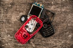 Quito, Ecuador, July 10, 2017: Close up of first generation mobile cellphone on wooden background Royalty Free Stock Photography