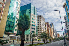 QUITO, ECUADOR - JULY 7, 2015: Commercial and bussines neighborhood in the north of the city, nice avenue with various. Buildings Royalty Free Stock Photo