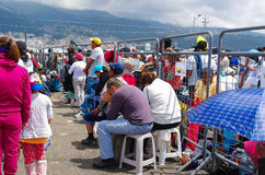 QUITO, ECUADOR - JULY 7, 2015: A couple of mature people sitting in the middle of the mass, praying under the sun Stock Photo