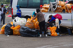 QUITO, ECUADOR - JULY 7, 2015: Garbage cleaners picking up all the trash after the event. Pope Francisco mass Royalty Free Stock Photos