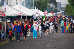 QUITO, ECUADOR - JULY 7, 2015: Long avenue crowded, people walking to see pope Francisco celebrating mess Royalty Free Stock Images