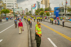 QUITO, ECUADOR - JULY 7, 2015: Lots of people expecting to see pope Francisco in Quito, police on the street Stock Image