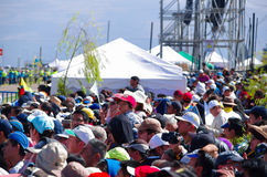 QUITO, ECUADOR - JULY 7, 2015: Lots of people with hats and caps waitting to see pope Francisco, tents behind. Sunny day Stock Photo