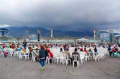 QUITO, ECUADOR - JULY 7, 2015: Lots of people sitting on white chairs waitting for pope Francisco mass. Firts time for Royalty Free Stock Photography
