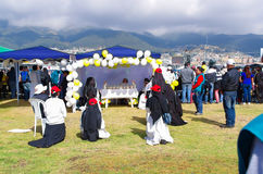 QUITO, ECUADOR - JULY 7, 2015: Nuns praying for pope Francisco, little altar in a tent with flowers and ballons in the Royalty Free Stock Photography