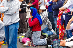 QUITO, ECUADOR - JULY 7, 2015: People on knees in the middle of the mass, praying. Family on the floor Royalty Free Stock Photos