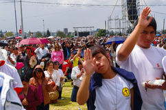 QUITO, ECUADOR - JULY 7, 2015: People raising the hand to receive blessings, pope Francisco mass event Royalty Free Stock Photo