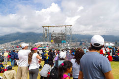 QUITO, ECUADOR - JULY 7, 2015: People very far from the scaffold looking and attending to mass on big screen.  stock images