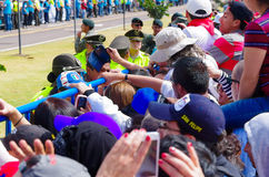 QUITO, ECUADOR - JULY 7, 2015: People very near from the metal fence, police guarding visitors on pope Francisco mass.  royalty free stock photos