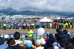 QUITO, ECUADOR - JULY 7, 2015: Police helping to guard people at pope Francisco mass, sunny day and tents Royalty Free Stock Photography