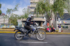 QUITO, ECUADOR - JULY 7, 2015: Police rolling in a motorcycle trough Quito streets, pope Francisco guard Royalty Free Stock Photos
