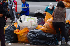 QUITO, ECUADOR - JULY 7, 2015: After pope Francisco mass, garbage cleaners putting all the trash in bags Stock Image