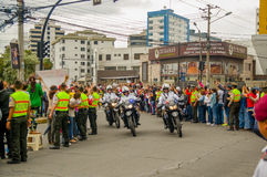 QUITO, ECUADOR - JULY 7, 2015: Three motorcycles helping pope Francisco with their security, police and people on the Royalty Free Stock Image