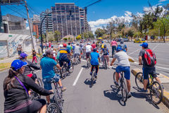 QUITO, ECUADOR - MARZO 23, 2015: Unidentified people waiting red light to passe trought important avenue. In a sunny day, trees and buildings around Stock Photo