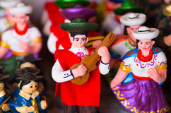 QUITO, ECUADOR- 07 MAY, 2017: Beautiful small figures of andean people made of clay over a white table.  royalty free stock photo