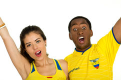 QUITO, ECUADOR - MAY 06, 2017: Close up of a young ecuadorian couple wearing official Marathon football shirt standing Stock Photography