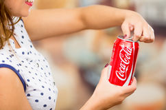Quito, Ecuador - May 06, 2017: Close up of a young woman pointing in from of her a coke wearing a white with black Royalty Free Stock Photos