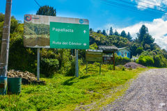 QUITO, ECUADOR - MAY 07, 2014: Informative sign in Papallacta, in a beautiful landscape in a sunny day with the road in Royalty Free Stock Images