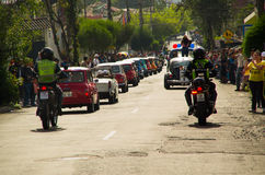 Quito, Ecuador - May 06, 2017: A parade of a group of cars before start the wood car racing inside of the streets of. Quito city Stock Photos