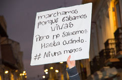 QUITO, ECUADOR- MAY 06, 2017: Woman holding a sign during a protest with the slogan alive we want them, protest against Royalty Free Stock Photo