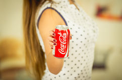 Quito, Ecuador - May 06, 2017: Young woman pointing in from of her a coke in a blurred background Stock Photography