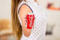 Quito, Ecuador - May 06, 2017: Young woman pointing in from of her a coke wearing a white with black points blouse Stock Photo