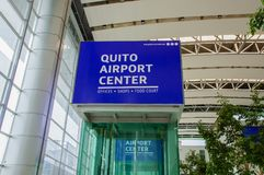 Quito, Ecuador - November 23 2017: Close up of informative sign of Quito airport center written with white letters in a. Blue background in the Mariscal Sucre Stock Image