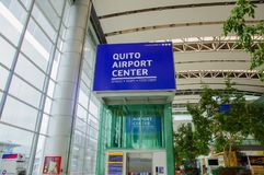 Quito, Ecuador - November 23 2017: Close up of informative sign of Quito airport center written with white letters in a. Blue background in the Mariscal Sucre Stock Photos