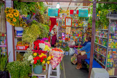 QUITO, ECUADOR - NOVEMBER 23, 2016: A flower market with some naturist medicine at the municipal market located in San. Francisco in Quito city royalty free stock photos