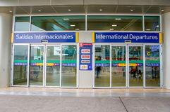 Quito, Ecuador - November 23 2017: Informative sign of international departures at the enter of the Mariscal Sucre. International Airport of the city of Quito Stock Image