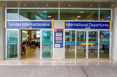 Quito, Ecuador - November 23 2017: Informative sign of international departures at the enter of the Mariscal Sucre. International Airport of the city of Quito Royalty Free Stock Images