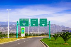 Quito, Ecuador - November 23 2017: Informative sign of Quito airport center located over the street in the city of Quito.  Royalty Free Stock Photography